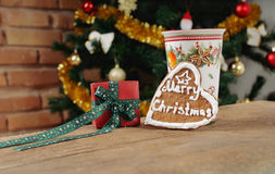 Present and cookie with cinamon cup of tea for Christmas Stock Photos