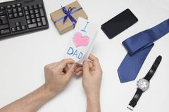 Present for dad. Father`s day. Children`s drawing. Son gives a gift to dad. Father`s Day stock images