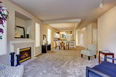 Present day living room with carpet and fireplace. Stock Photo
