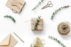 Present design in box with flowers on white background top view. Homemade present design in box with flowers on white background top view Royalty Free Stock Photos