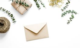 Present design in box with flowers on white background top view. Homemade present design in box with flowers on white background top view mockup Royalty Free Stock Images