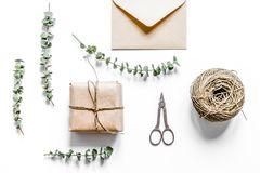 Present design in box with flowers on white background top view. Homemade present design in box with flowers on white background top view Stock Photography