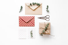 Present design in box with flowers on white background top view mockup. Homemade present design in box with flowers on white background top view mockup Royalty Free Stock Photo