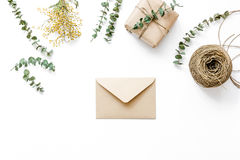 Present design in box with flowers on white background top view mockup. Homemade present design in box with flowers on white background top view mockup Royalty Free Stock Image