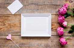 Present design with peony bouquet and white frame top view mock up Stock Image