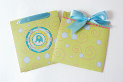 Present envelopes for baby boy. Greeen present envelopes for baby boy with blue tape on the white background Stock Images