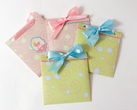 Present envelopes for baby. Four present envelopes for baby with blue and pink tape on the white background Royalty Free Stock Photo