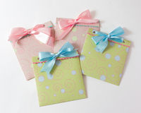 Present envelopes for baby. Four present envelopes for baby with blue and pink tape on the white background Royalty Free Stock Photography