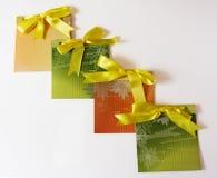 Present envelopes. Four handmade envelopes with yellow tape on the white background Stock Photo