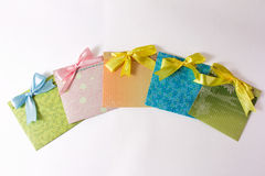 Present envelopes for party. Five present colorful handmade envelopes for party on the white background Stock Photo