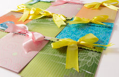 Present envelopes for party. Nine present colorful handmade envelopes for party on the white background Stock Photos