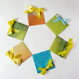 Present envelopes. Six handmade envelopes with yellow tape on the white background Stock Photography
