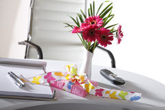Present and flower vase on office table Stock Images