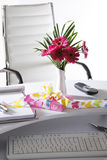 Present and flower vase on office table Royalty Free Stock Images