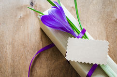 Present with fresh flower and blank note. Present with fresh flower and blank note on wooden table. Holidays background. Selective Focus Royalty Free Stock Photos