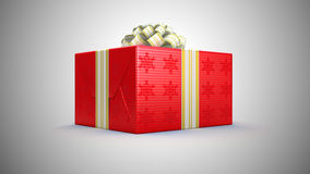 Present or gift box with bow over grey Royalty Free Stock Photos