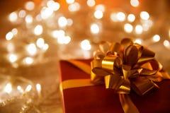 Present Gift Box Bow Ribbon, Christmas Decoration Lights. Present Gift Box with Bow Ribbon, Christmas Decoration over Defocused Night Lights Background Royalty Free Stock Photography