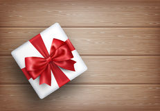 Present Gift Box with Bow on Wooden Royalty Free Stock Photography