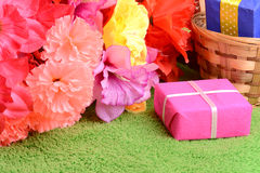 Present gift box and flower bouquet on silk Stock Photo