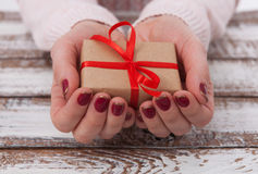 Present. Gift box. Woman holding small gift box with ribbon. Stock Images
