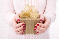 Present. Gift box. Woman holding small gift box with ribbon. Royalty Free Stock Photo