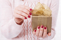 Present. Gift box. Woman holding small gift box with ribbon. Royalty Free Stock Photography