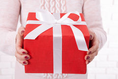 Present. Gift box. Woman holding small gift box with ribbon. Royalty Free Stock Images