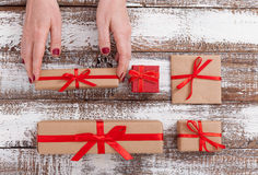 Present. Gift box. Woman holding small gift box with ribbon. Stock Photo