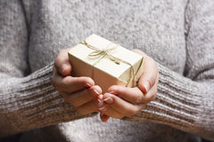 Present,  gift. Close up of female hands holding small gift Stock Photos