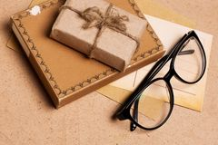 Present gift from grunge paper with glasses Royalty Free Stock Photo
