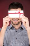 Present gift in hands of smiling man. Stock Photo
