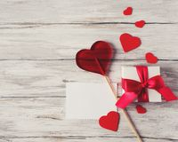 Present Gift With Red Ribbon Hearts Candy Lollipop Blank Note On Stock Images