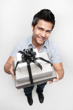 Present given by an attractive asian man Stock Photos
