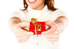 Present Giving Girl. Conceptual Closeup Photo Of A Cute Smiling Woman Offering A present Stock Images