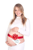 Present from God. A blong pregnant woman in white cloth with red bow and note from God on a bump Stock Photography