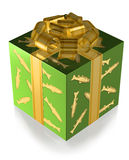 Present Green with Fish and Gold band. Present wrapped in shiny green and fish decorated paper with golden ribbon, isolated Royalty Free Stock Photo