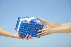 present and hands sky background Royalty Free Stock Images