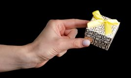 Present jewerly box in hand. On black background isolation royalty free stock images