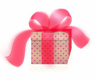 Present with large red bow. A special present or gift tied with a large ribbon and bow Stock Photo