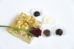 Present with letter, red rose and chocolate Royalty Free Stock Images