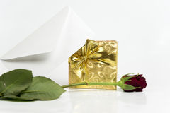 Present with letter and red rose Royalty Free Stock Photo