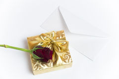 Present with letter and red rose Stock Image