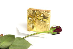 Present with letter and red rose Royalty Free Stock Images