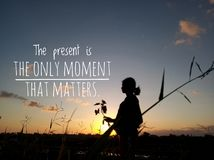 The present is the only moment that matters, silhouette image with text quote words of wisdom stock image