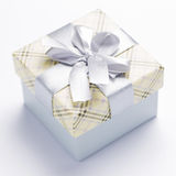 Present package and garlands Royalty Free Stock Photography