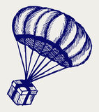 Present and parachute falling from the sky Royalty Free Stock Images