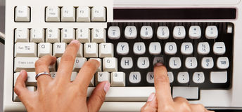 Present and Past technology. Found an old keyboard and typewriter that has similar line width, combine the photo of the keyboard and typewriter into this one Royalty Free Stock Photo
