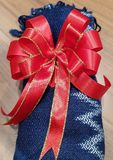 Present in red bow. royalty free stock photos