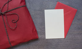 Present in red pack with envelope. Top view Stock Image