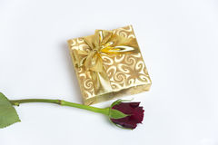 Present with red rose. Present in a golden box with red rose Royalty Free Stock Photography